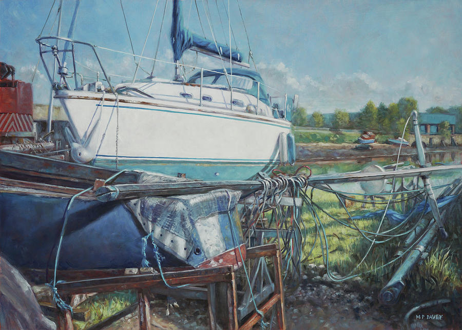 Boat out of water with dumped parts at marina by Martin Davey