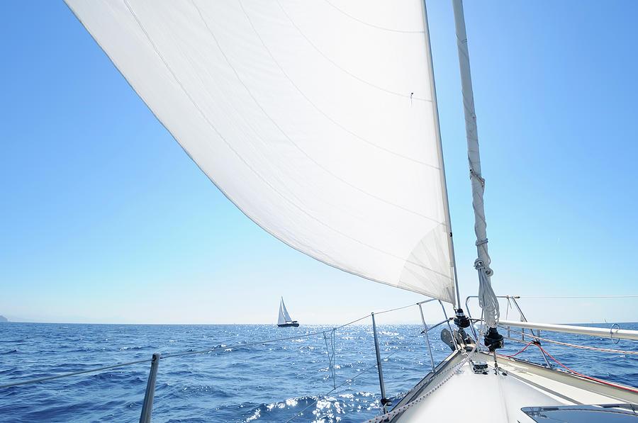 Boat Sailing Towards The Horizon Photograph by Nikitje
