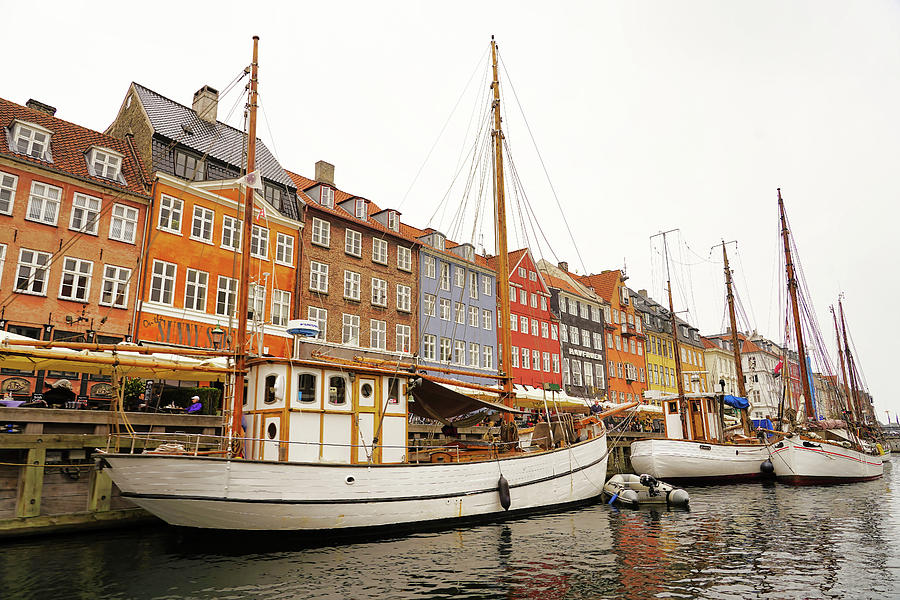 Boats Docked On A Canal In Copenhagen Denmark by Richard Rosenshein