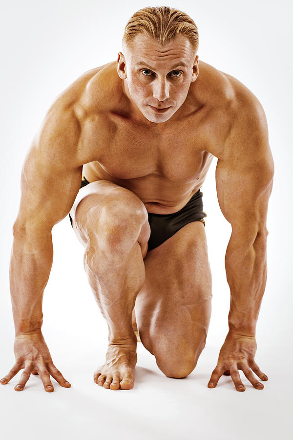 Body Builder Posing On White Background Photograph by Anouchka