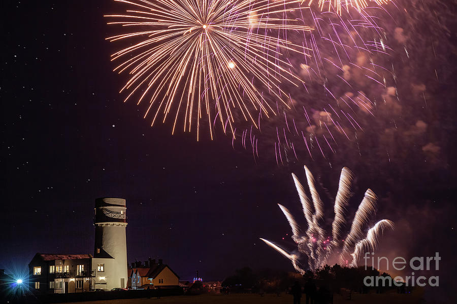 Bonfire night foreworks over lighthouse in Norfolk by Simon Bratt Photography LRPS