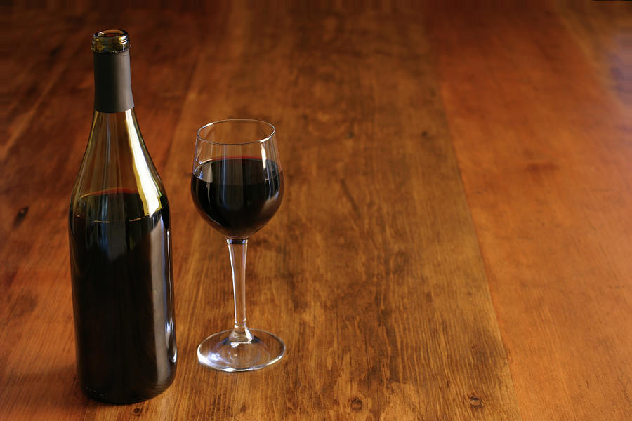 Bottle & Glass Of Red Wine On Rustic Photograph by Donald gruener