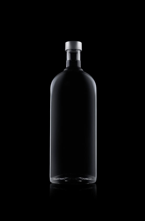Bottle Of Water Isolated On Black Photograph by Kedsanee