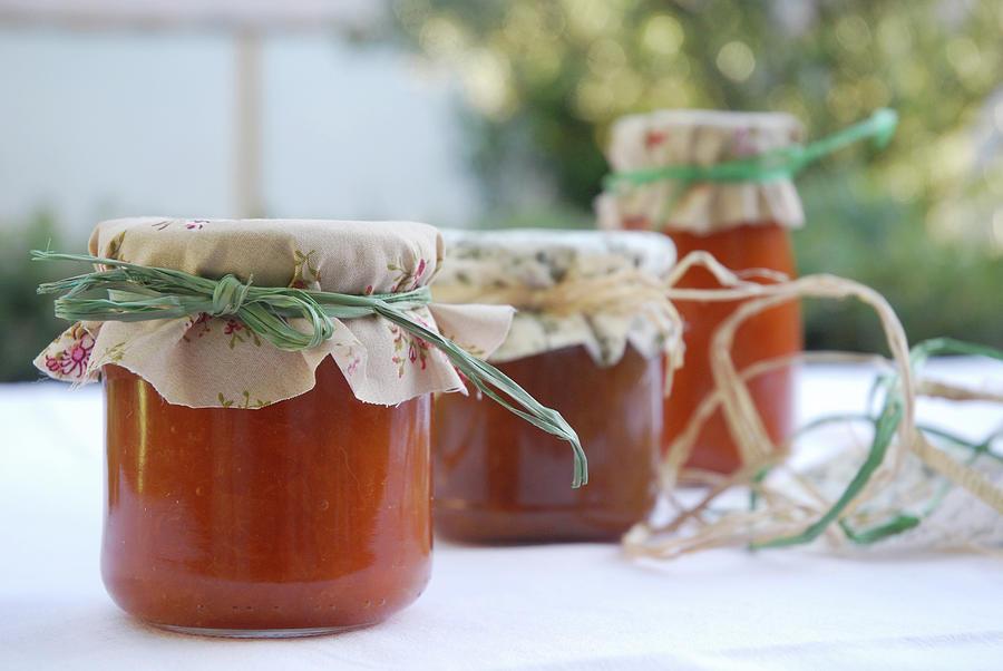 Bottles Of Apricot And Plum Jam Photograph by Por Cristi López