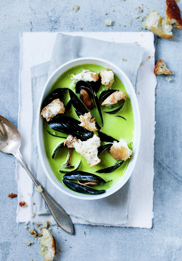 Bowl Of Pea And Mussels Soup Photograph by Line Klein