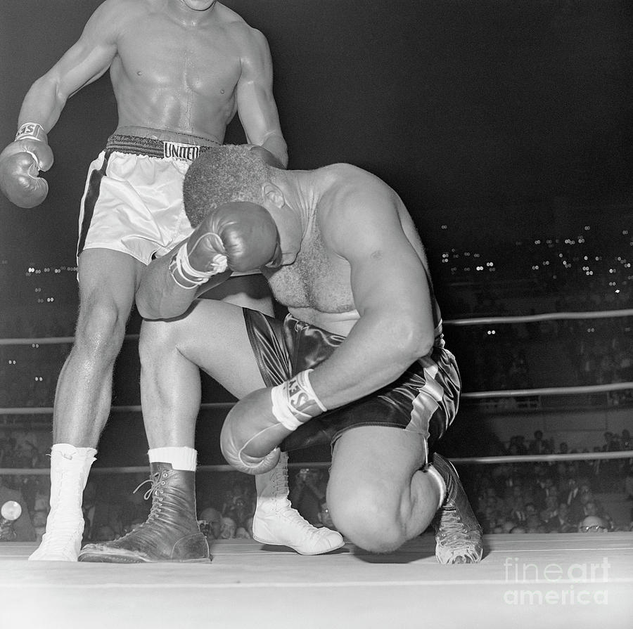 Boxer Cassius Clay Defeating Archie Photograph by Bettmann