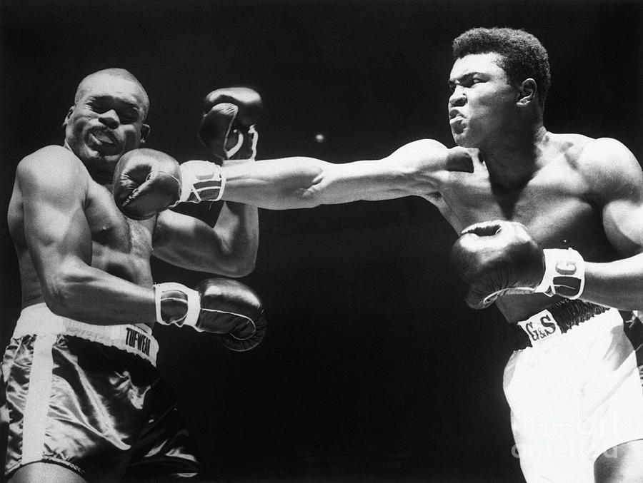 Boxer Cassius Clay Punching Doug Jones Photograph by Bettmann