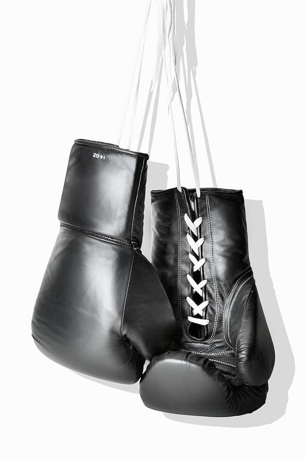 Boxing Gloves Hanging Against White Photograph by Burazin