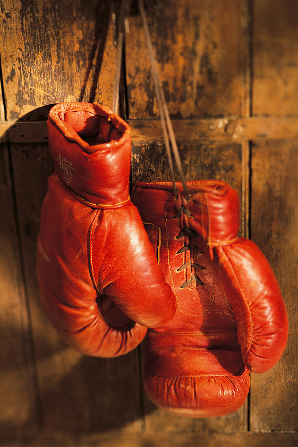 Boxing Gloves Hanging On Rustic Wooden Photograph by Comstock