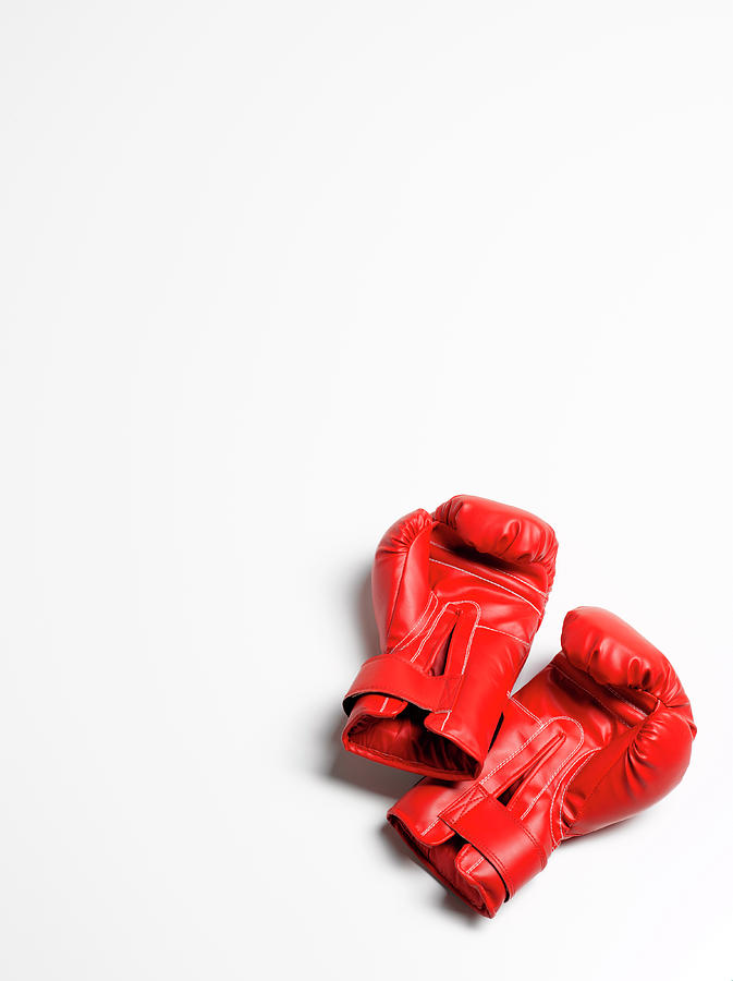Boxing Gloves On White Background Photograph by Peter Dazeley