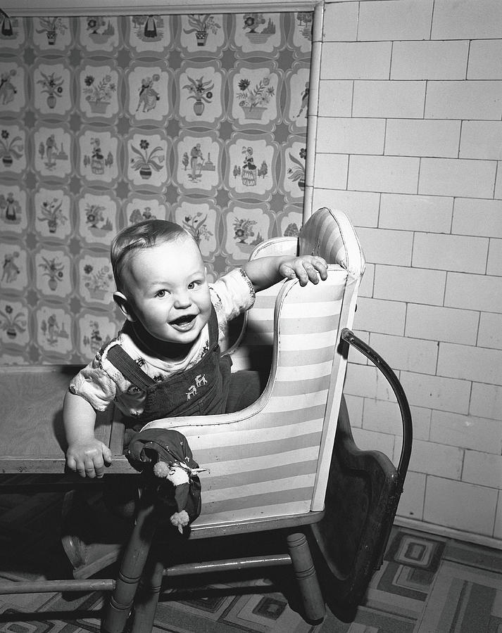 Boy 2-3 Sitting In High Chair,  B&w Photograph by George Marks