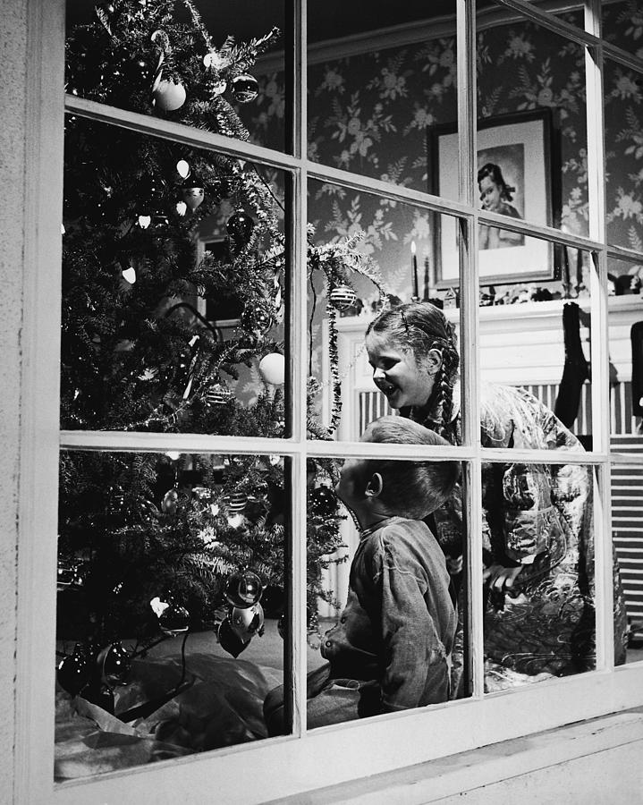 Boy And Girl 3-8 Looking At Christmas Photograph by Fpg