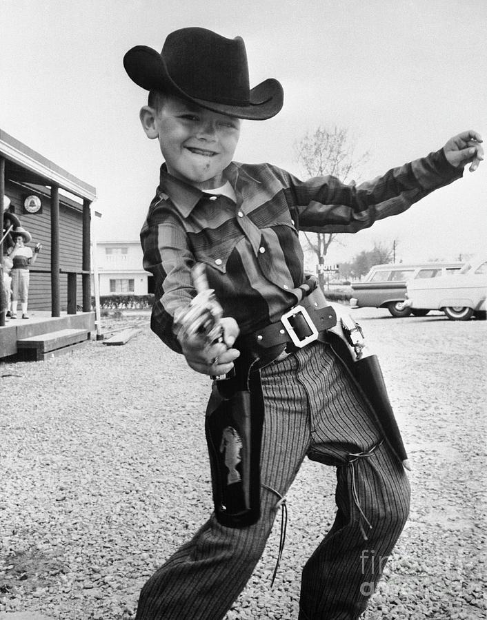 Boy Drawing Toy Pistol Photograph by Bettmann