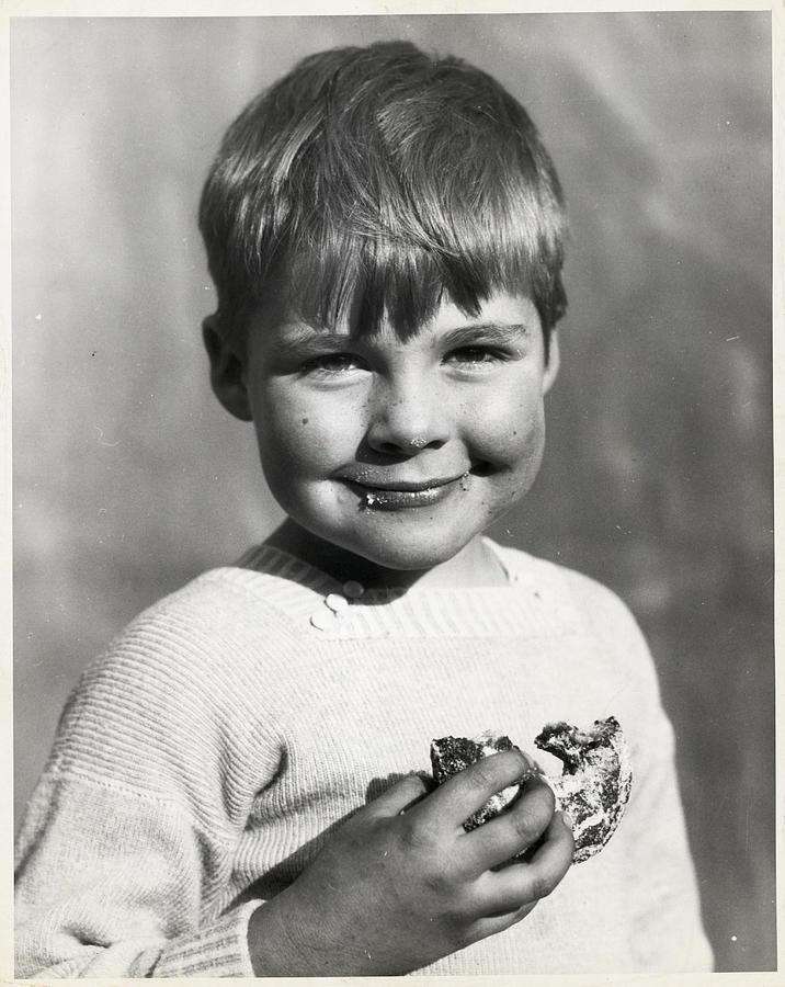 Boy Eating Doughnut Photograph by Bettmann