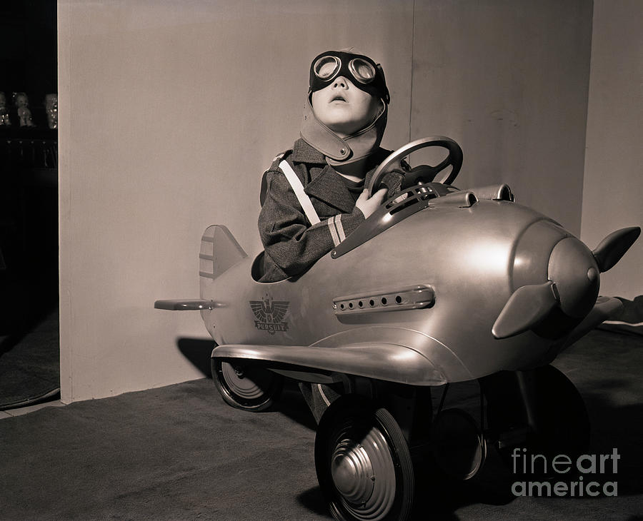 Boy In Aviator Suit Sitting In Toy Plane Photograph by Bettmann