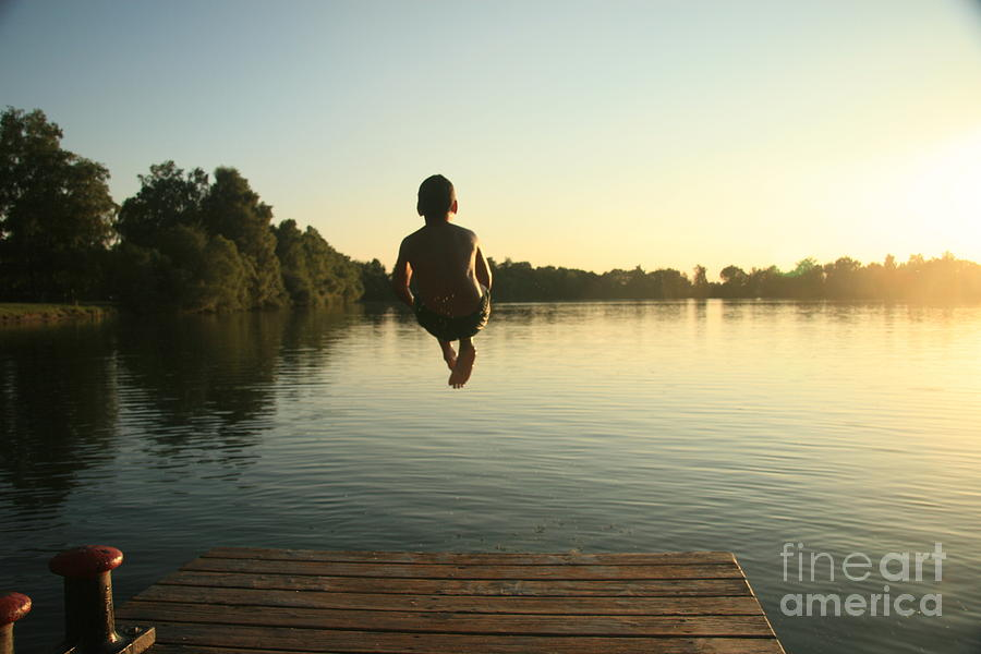 Country Photograph - Boy Jumping Into A Lake From A Dock At by David Polite