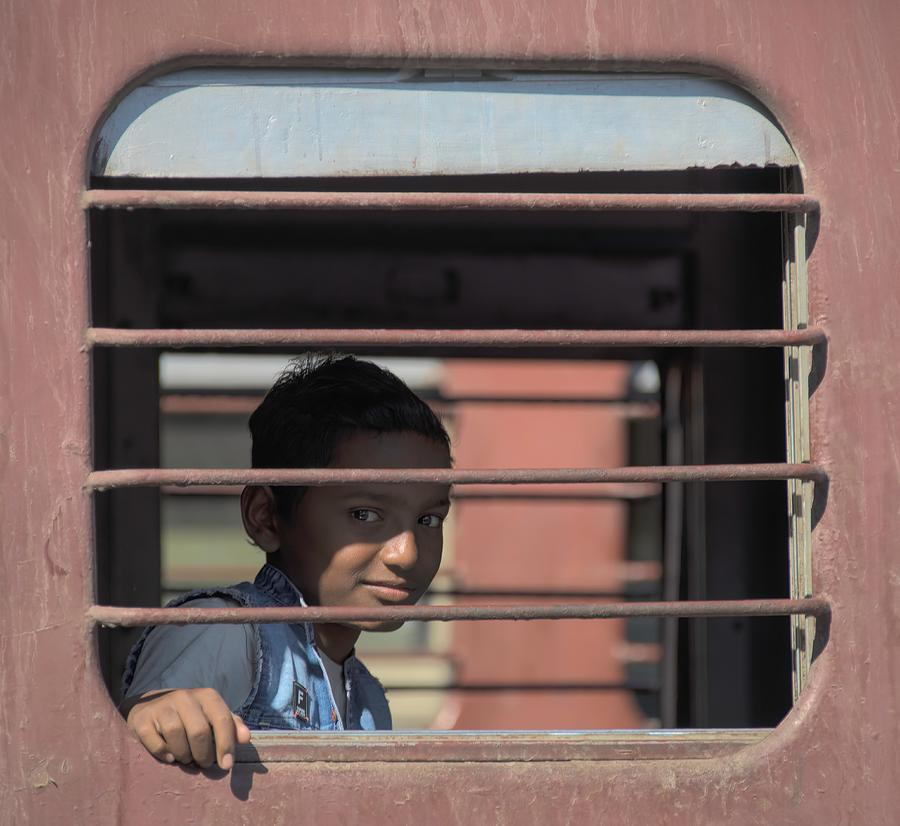 Boy on a train by James Kenning