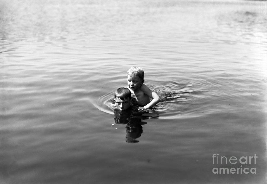 Boy Teaching Friend To Swim Photograph by Bettmann