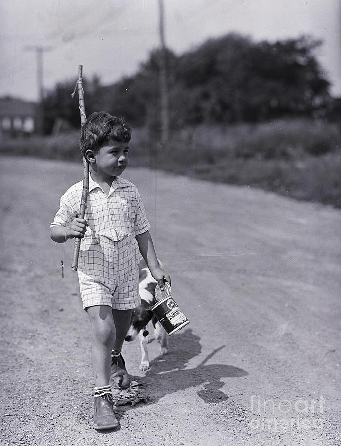 Boy Walking With Fishing Stick Photograph by Bettmann