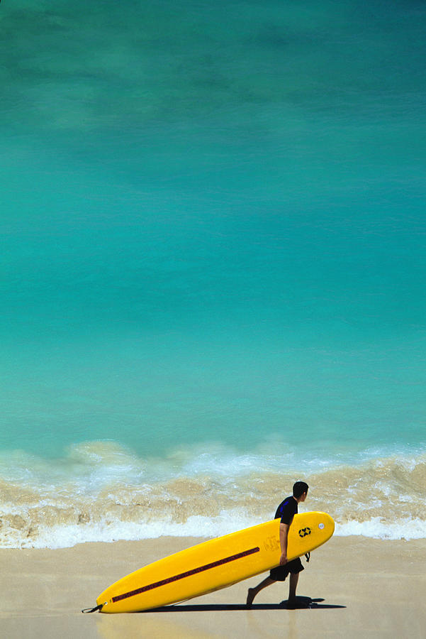 Boy With Yellow Surfboard At Waikiki Photograph by Ann Cecil