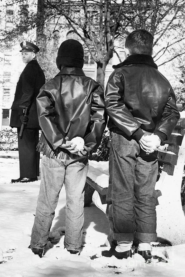 Boys Hiding Snowballs Behind Their Backs Photograph by Bettmann