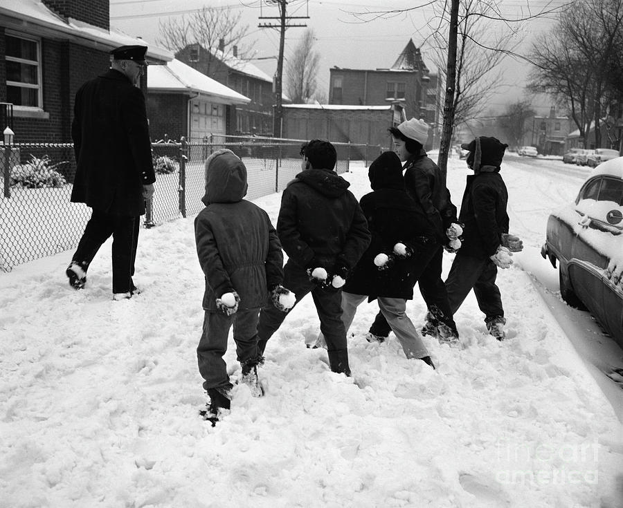 Boys Hiding Snowballs Photograph by Bettmann