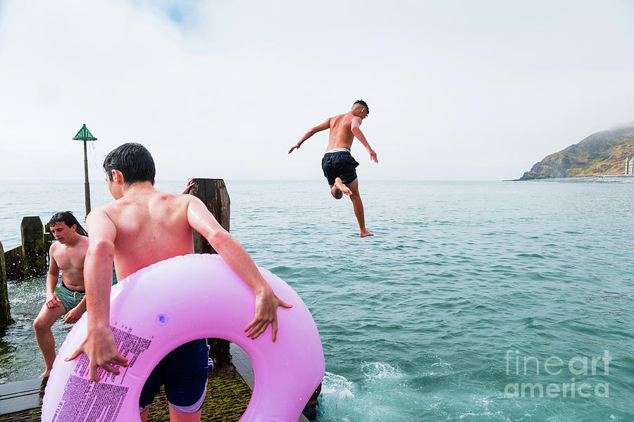 Boy Photograph - Boys Jumping Into The Sea by Keith Morris