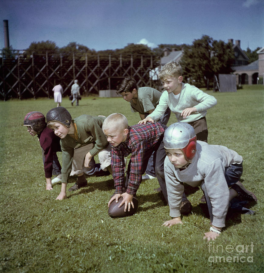Boys Playing Football Photograph by Bettmann