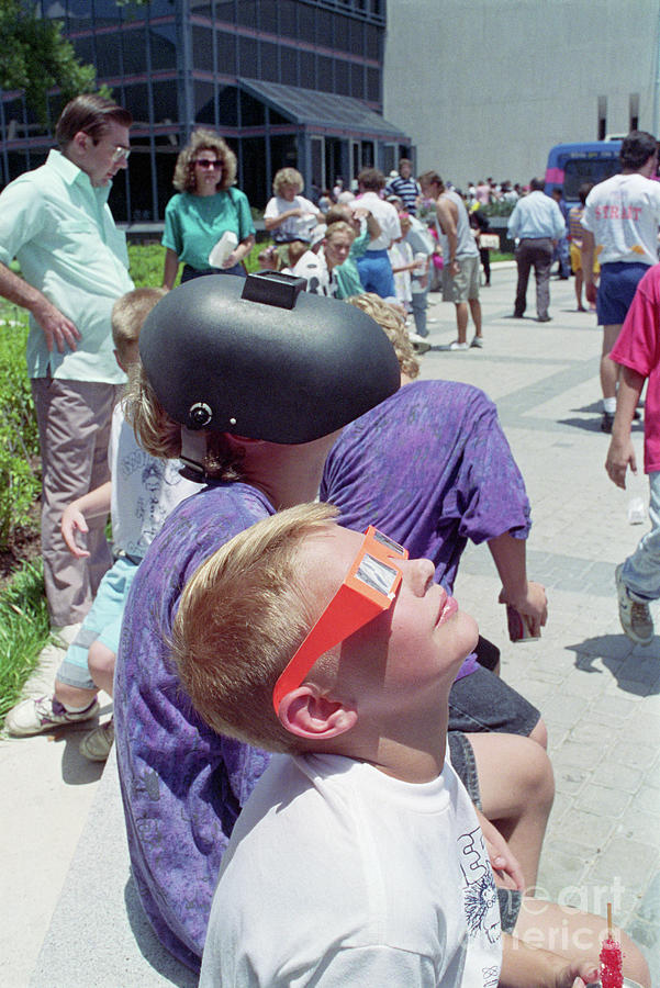 Boys Watching A Solar Eclipse Photograph by Bettmann