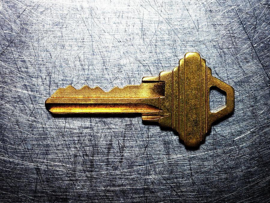 Brass Key On Stainless Steel Photograph by Ballyscanlon