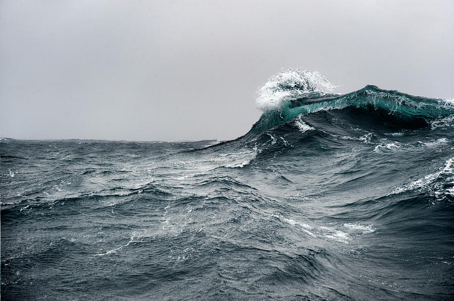 Breaking Wave On A Rough Sea Against Photograph by Mike Hill