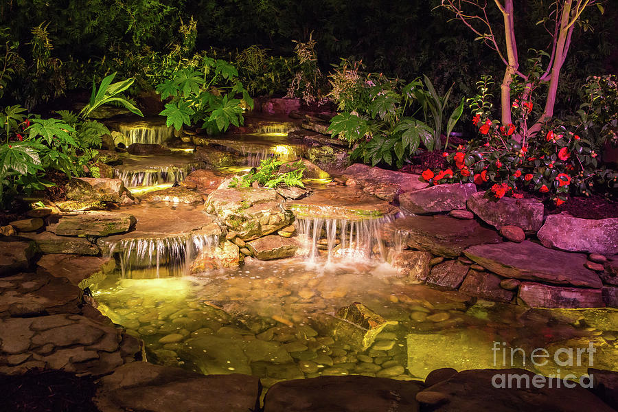 Brilliantly lit waterfall at night by Kevin McCarthy