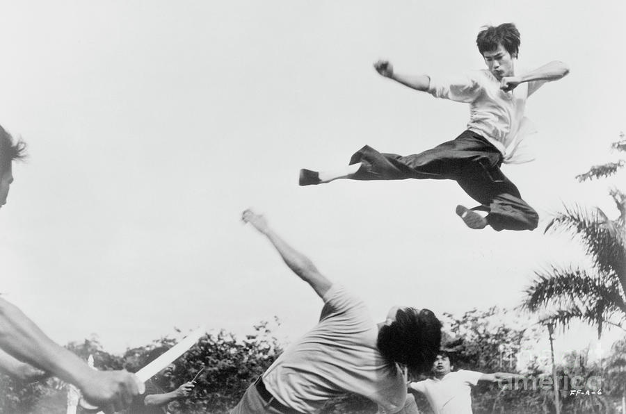 Bruce Lee Jumping In The Air Photograph by Bettmann