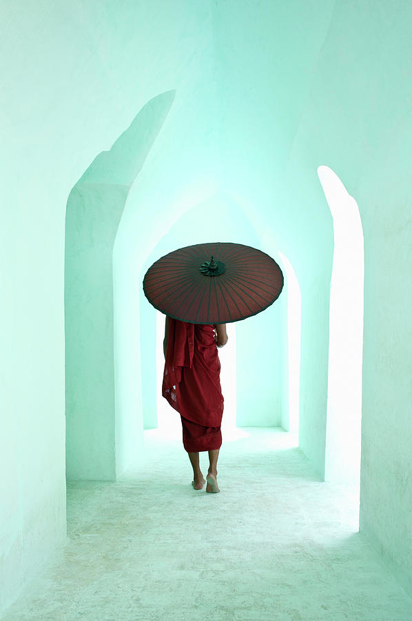 Arch Photograph - Buddhist Monk Walking Along Arched by Martin Puddy