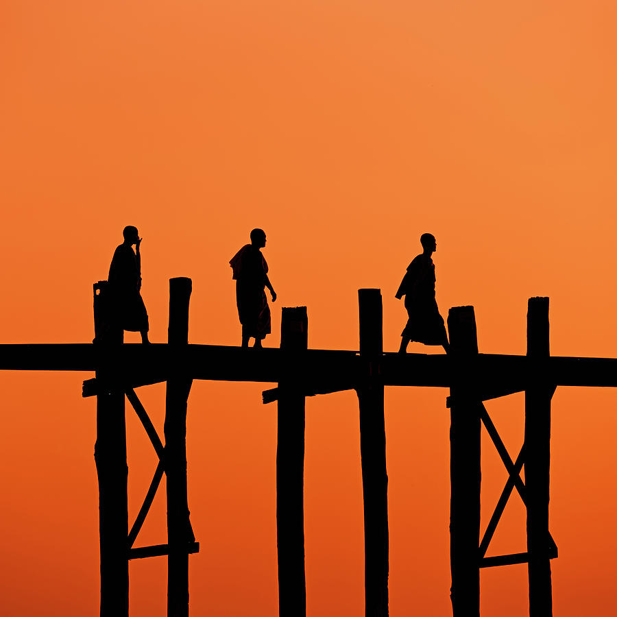 Buddhist Monks Crossing U Bein Bridge Photograph by Hadynyah
