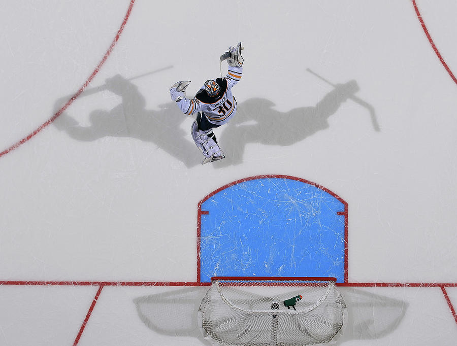 Buffalo Sabres V New York Islanders Photograph by Bruce Bennett