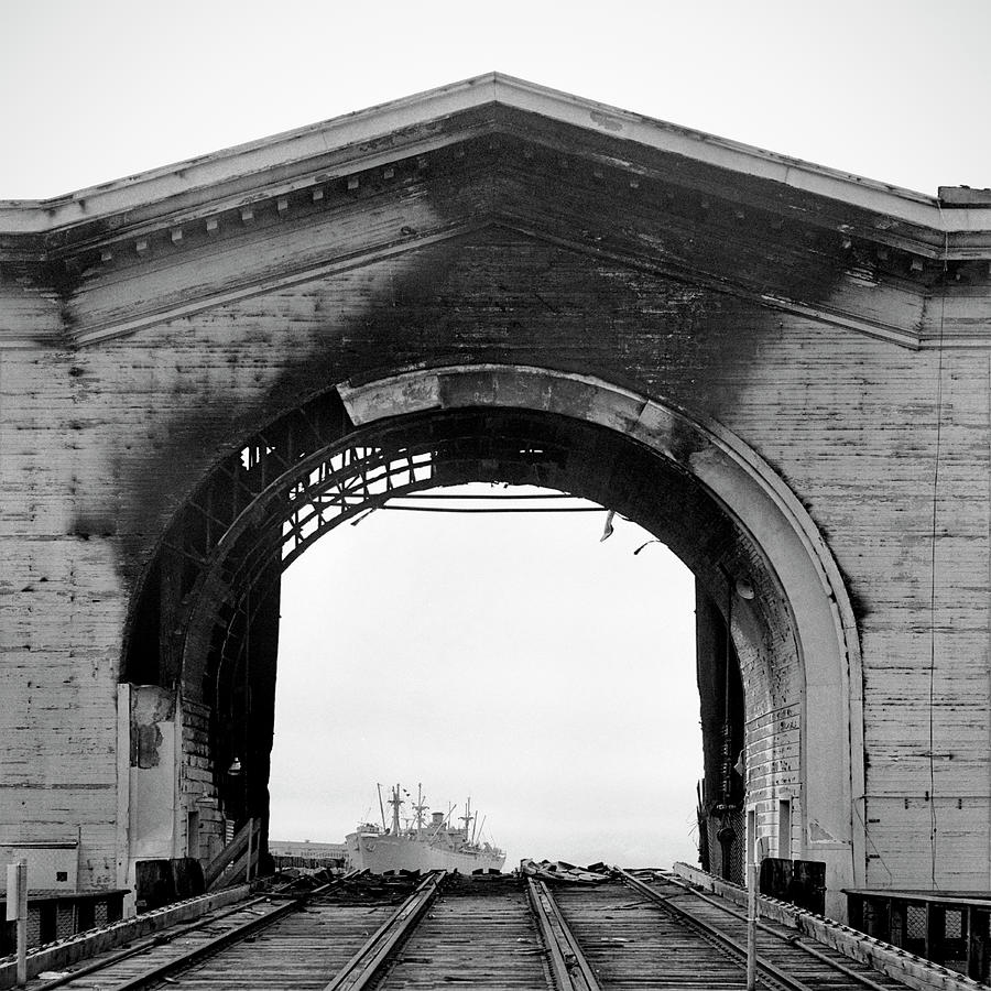 Burned Arch Over Railroad Tracks Photograph by Studio 642