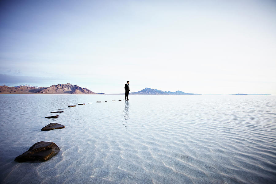 Businessman Standing At The End Of Photograph by Thomas Barwick