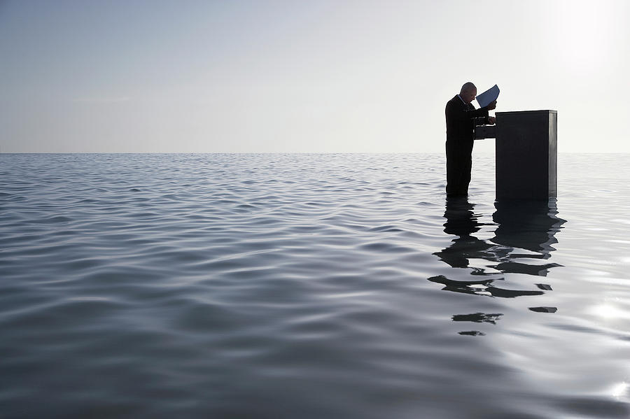 Businessman Standing In The Ocean Photograph by Moodboard