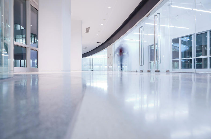 Businessmen Walking In A Modern Interior Photograph by Beijingstory