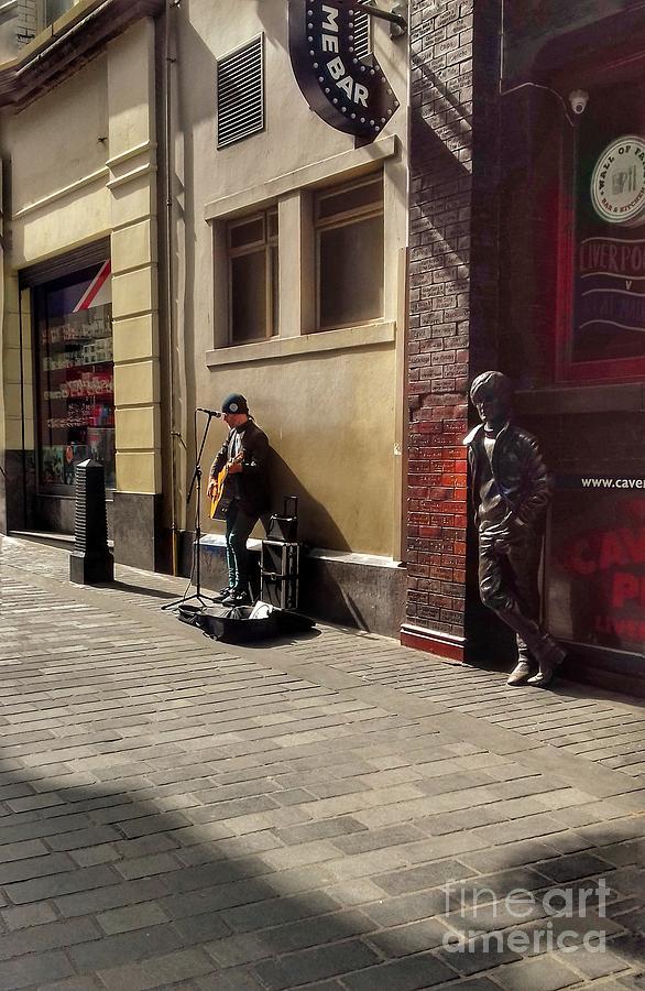 Busker on Mathew Street by Joan-Violet Stretch