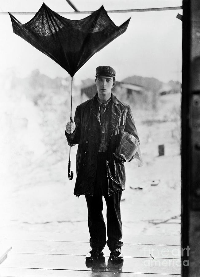Buster Keaton Holding Broken Umbrella Photograph by Bettmann