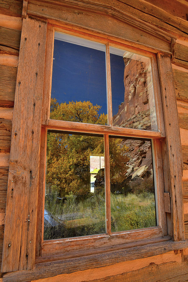 Buttes and Fall Color reflected in Fruita School window in Capitol Reef NP by Ray Mathis