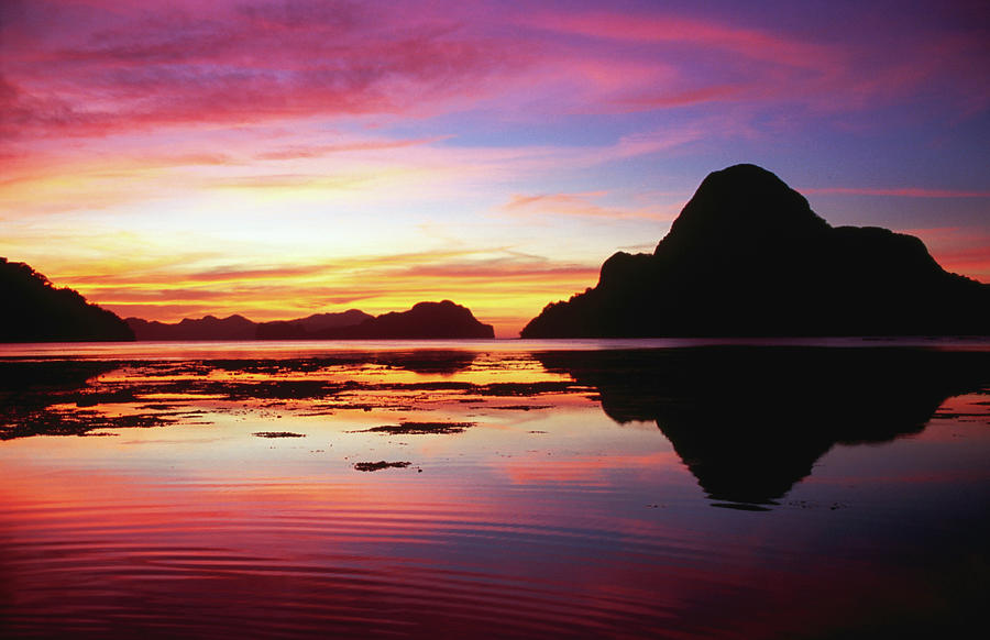 Cadlao Island Silhouetted At Sunset Photograph by Dallas Stribley