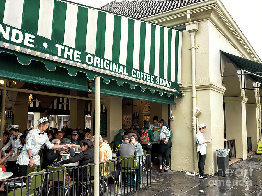 Cafe Du Monde Photograph - Cafe Du Monde Situation In New Orleans by John Rizzuto