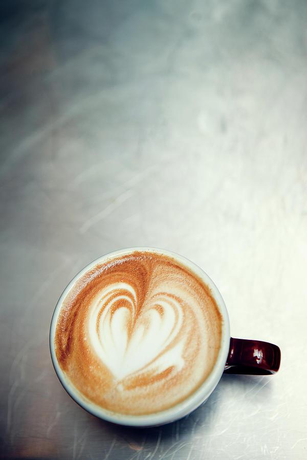 Caffe Macchiato Heart Shape On Brushed Photograph by Ryanjlane