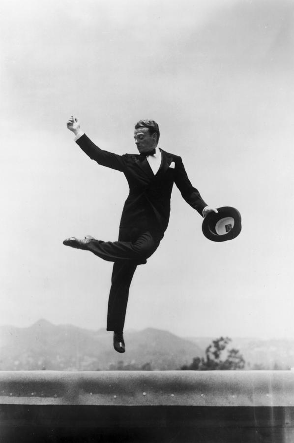 Cagney Leaping In Formal Attire Photograph by Getty Images