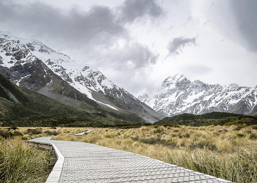 Wooden Walkaway Leading To Aoraki / Mount Cook On A Cloudy Day by Peter Kolejak