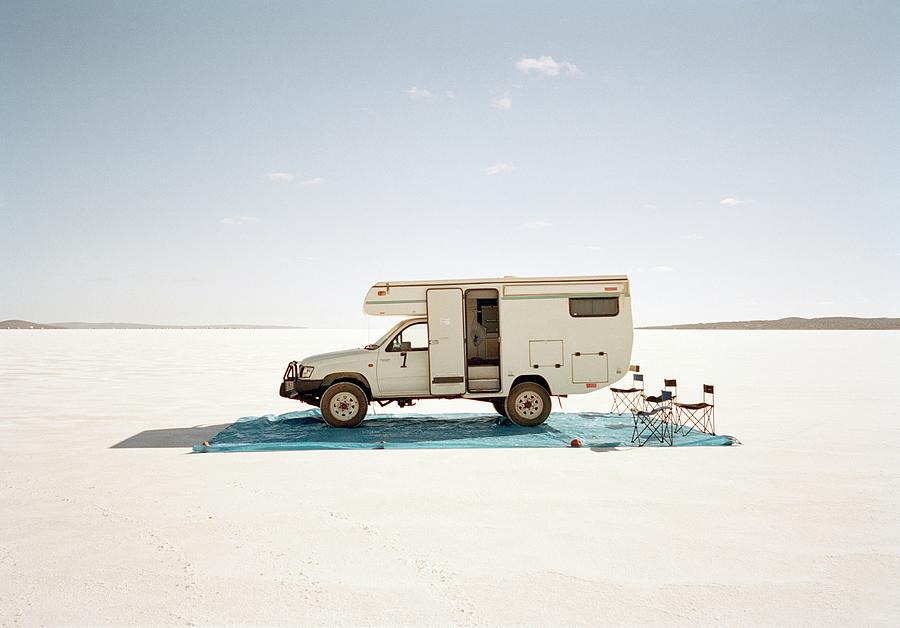 Camping With Motor Home On Salt Flat Photograph by Tobias Titz