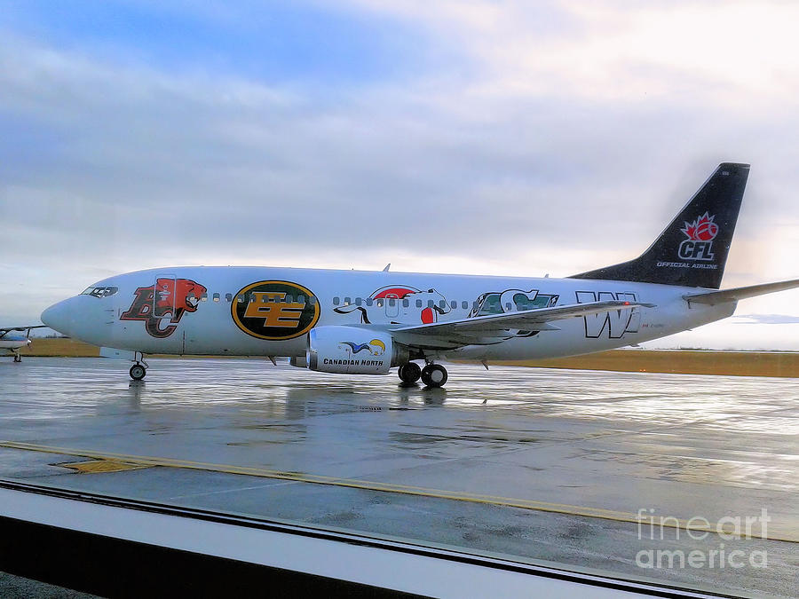 Canadian Football League official  plane   by Elaine Manley